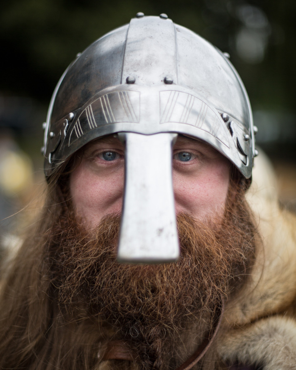 Man with a beard and viking helmet